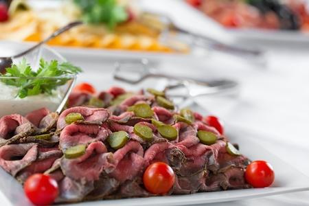 freshly prepared: Slices of freshly prepared roast beef on a plate