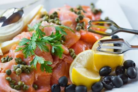 garnish: Trinley sliced salmon on plate with garnish