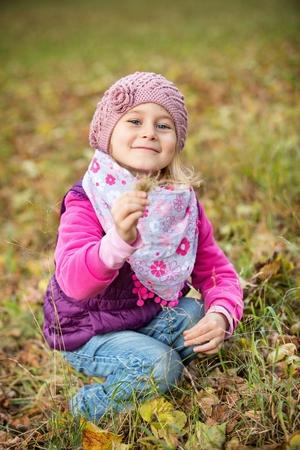 young leaf: Portrait little girl in autumn park