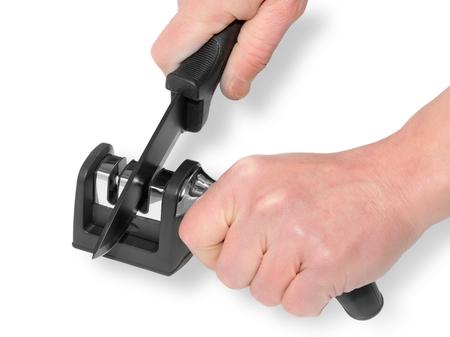 sharpening knives per help a whetstone Reklamní fotografie - 53025360