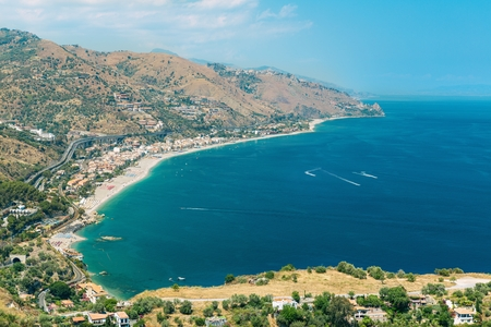 taormina: The bay of Giardini-Naxos with the Etna and Catania in the background viewed from Taormina, Sicily Italy