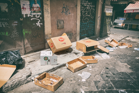 catania: Catania,25 july 2016: Cardboard boxes and other trash littered the streets freely in city of Catania on the island of Sicily - Italy in July 2016