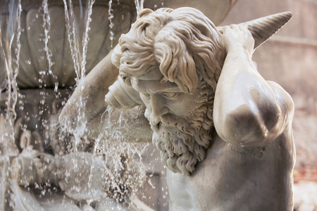 Detail of the Amenano fountain, in Catania, Sicily Italy. It Represents the Amenano river as a young man holding a cornucopia from Which flows out of the water That is poured into a tank