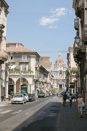 sant agata: CATANIA, Sicily, ITALY - JUL 25, 2016: Street leading to the Cathedral of Saint Agatha in Catania, Sicily