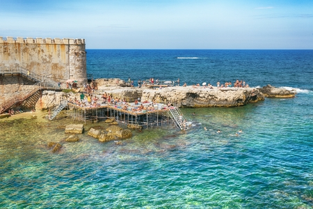 ortigia: Syracuse, Sicily, Italy in July 26 2016. People Bathers on Ortigia Island, Syracuse, Sicily. Italy.