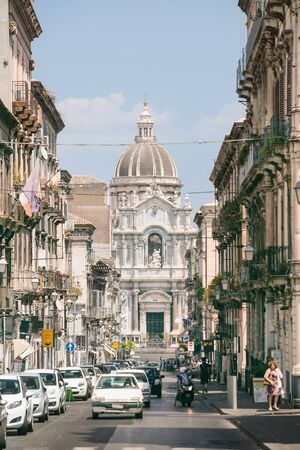 cattedrale: CATANIA, Sicily, ITALY - JUL 25, 2016: Street leading to the Cathedral of Saint Agatha in Catania, Sicily