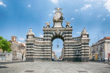 CATANIA, Sicily, ITALY - JUL 25, 2016: The arch Giuseppe Garibaldi (was built to honor the Spanish King Ferdinand I.) of Catania , is a triumphal arch built in 1768