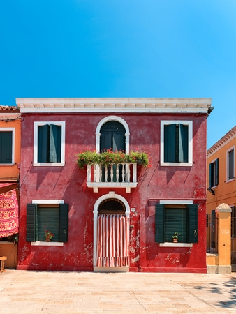 Colorful houses taken on Burano island , Venice, Italy in summer time. Positive color makes beautiful background from them.
