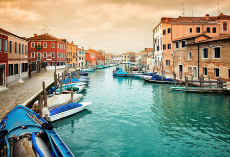 Narrow canal among old colorful houses on island of Murano, near Venice in Italy. Editorial