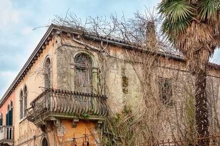 damaged roof: Old derelict house on the island of Murano in Venice, Italy