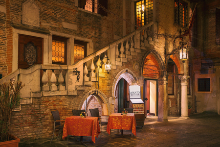 Night view of restaurant in Venice, Italy. Architecture and landmarks of Venice. Nightlife of Venice. Venice postcard
