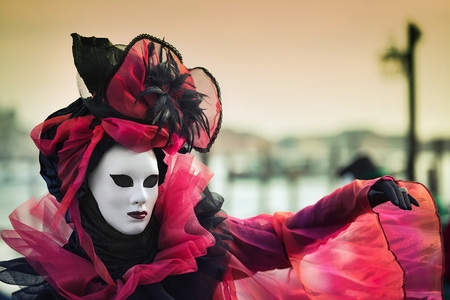 rialto: Venice, Italy - February 27, 2014: Unidentified person with Venetian Carnival mask in Venice, Italy on February 2014. In 2014 the Venetian Carnival was held Between February 15 and March 4 Editorial
