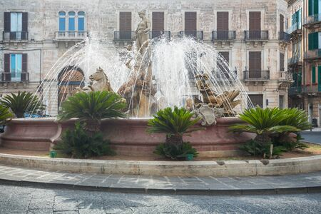 neoclassic: Diana fountain in the center of Siracusa - piazza Archimede  Syracuse, Sicily, Italy: sculptures of Archimede Square. Beautiful representative picture of Sicilian and Italian tourism. Stock Photo