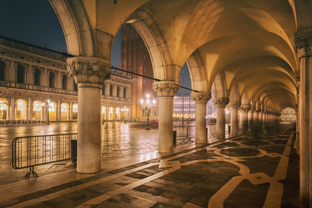 NIGHT VENICE, ITALY, Palazzo Ducales arcade, ancient doges palace, in the famous San Marcos square, in Venice.