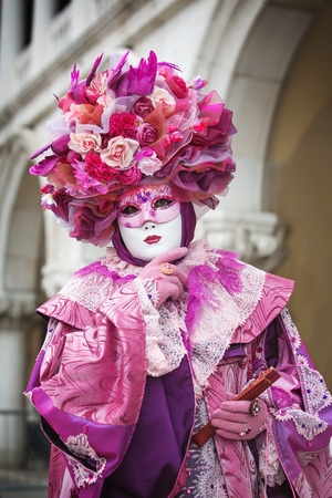 VENICE, ITALY - FEBRUARY 27, 2014: Unidentified person with Venetian Carnival mask in Venice, Italy on February 2014. In 2014 the Venetian Carnival was held Between 15 February and 4 March