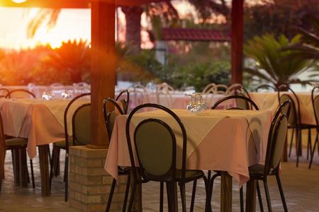 Empty outdoor restaurant table at sunset Reklamní fotografie