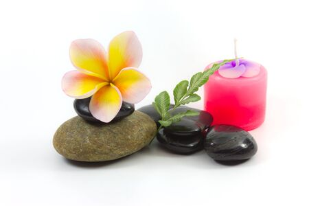 Spa stones and Frangipani flower photo