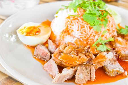 Rice with roasted pork with sauce. photo