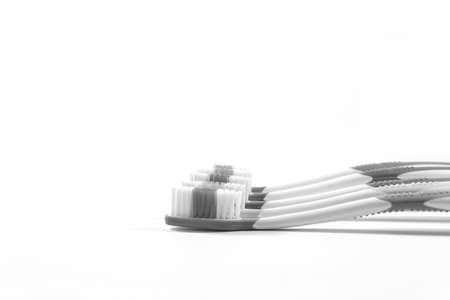 Black and white a toothbrushes.