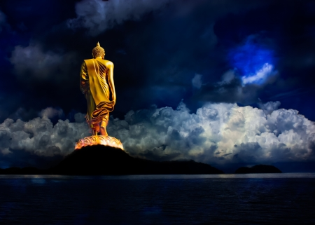 veneration: Buddha statue walking on the mountains. Stock Photo
