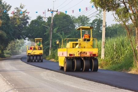 steamroller: Steamroller are crushed the asphalt road.