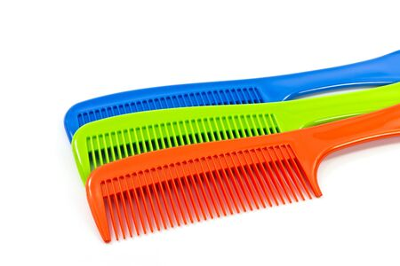 long handled: The  comb on a white background