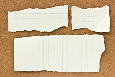 Note papers on wooden background. photo