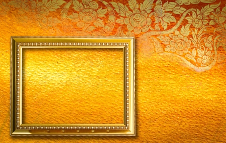 Gold picture frame on the golden thai pettern. photo