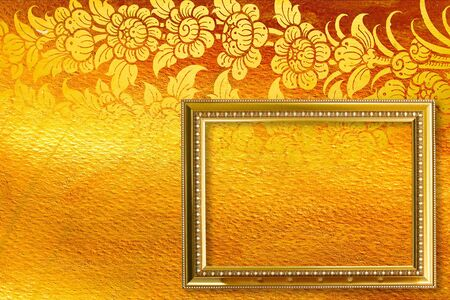 Gold picture frame on the golden thai pattern. photo
