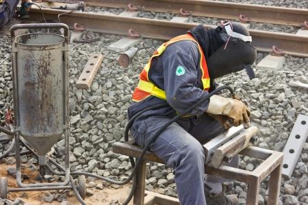 sandblasted: Workers repair the railway tracks with Sandblasted.
