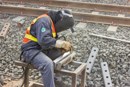 Workers repair the railway tracks with Sandblasted.
