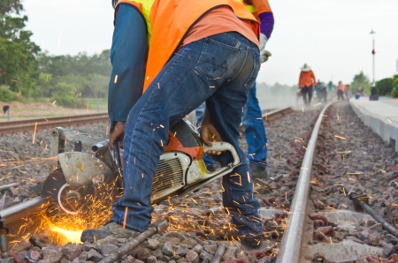 Workers were cutting tracks for maintenance. 版權商用圖片 - 22096231