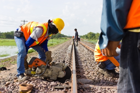 steelwork: Workers were cutting tracks for maintenance. Stock Photo