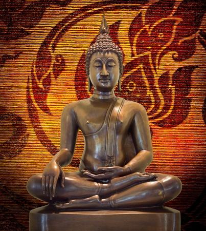 Buddha statue on a grunge background. photo