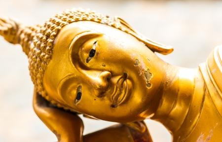 meditaion: Golden reclining Buddha. Stock Photo