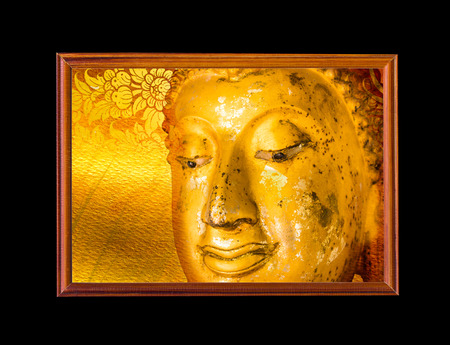 Buddha face in wooden frame. photo