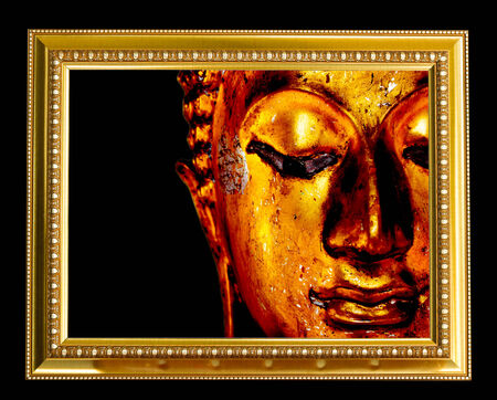 Buddha face in gold frame. photo