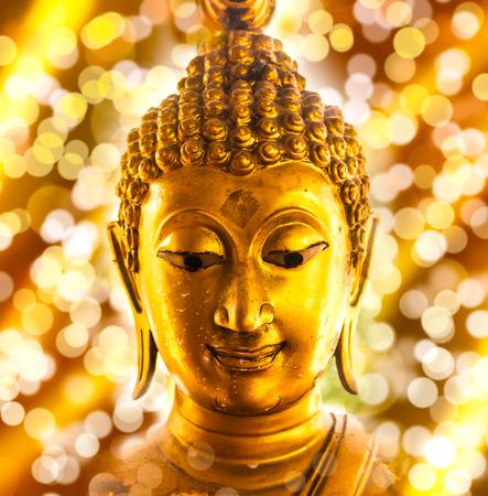 buddha tranquil: Buddha gold statue on bokeh background. Stock Photo
