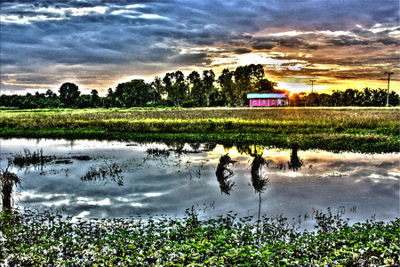 Watercolor paintings sunset on countryside. Stock Photo