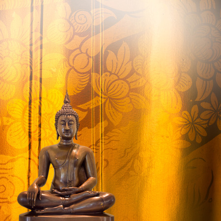 Buddha statue on golden pattern Thailand background.