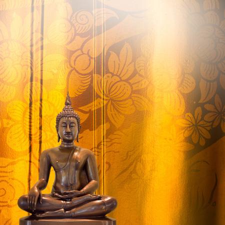 thai decor: Buddha statue on golden pattern Thailand background.