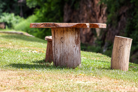 constructed: Wooden table constructed from the tree in bright day.