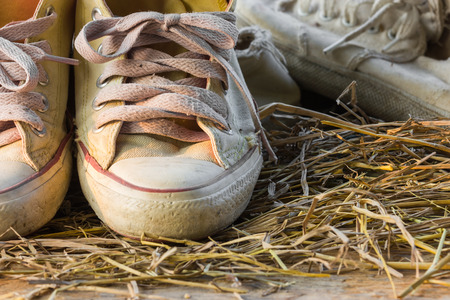 tearing down: Old sneakers.