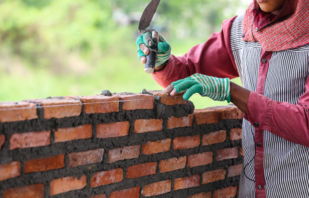clay brick: Workers masonry Clay brick to wall. Stock Photo