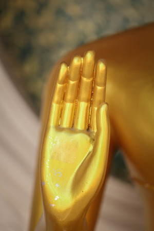 travelled: Hand of gold Buddha in Thailand. Stock Photo
