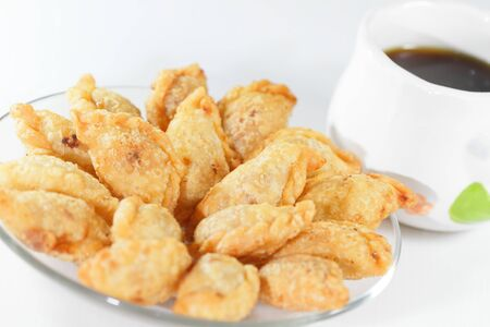 Thai style curry puffs with coffee Stock Photo