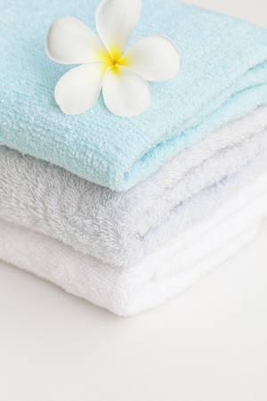 set of towel and plumeria flower photo