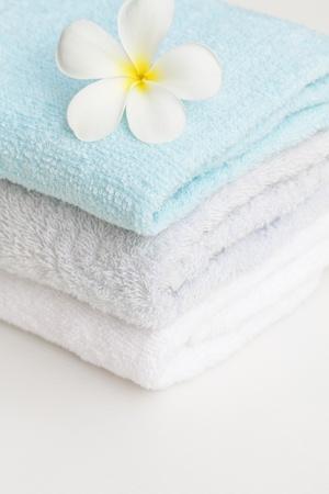 set of towel and plumeria flower