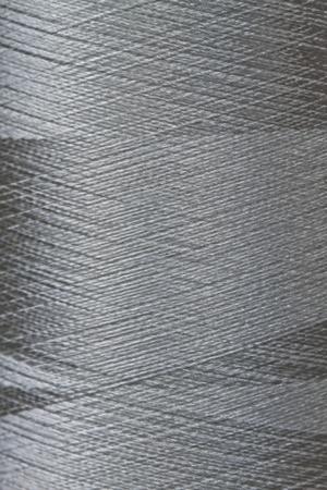 texture of grey thread in spool