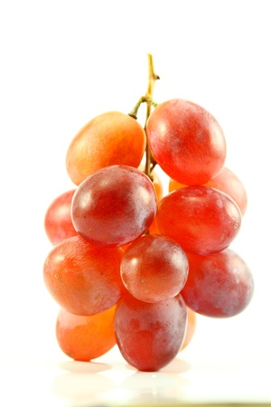 red grapes isolated on white photo